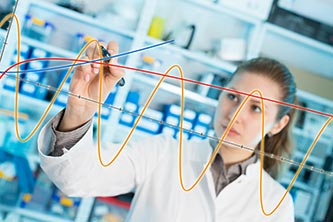 A female scientist plotting a graph in a laboratory